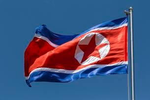 North Korea flag blowing in the wind, blue skyの写真素材 [FYI02339987]