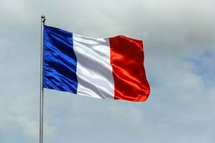 French flag, cloudsの写真素材 [FYI02340127]
