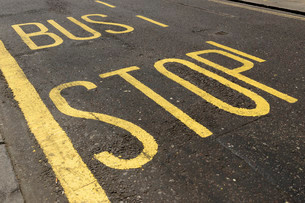 Lettering on road at bus stop, London, England, Unitedの写真素材 [FYI02340425]
