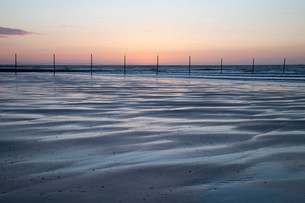 Evening mood at the North Sea at low tide, Wangerooge, Eastの写真素材 [FYI02340790]