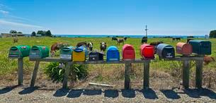 Several mailboxes at a cow pasture, East Cape, Gisborneの写真素材 [FYI02340812]
