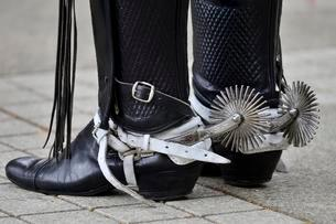 Man in riding boots with spurs, detail, island Chiloeの写真素材 [FYI02343603]