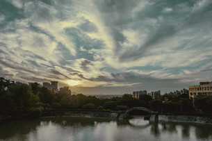 Overview of the city beside river with fantasy skyの写真素材 [FYI02344205]