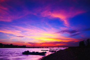 Overview of the coast and bridge with colorful fantasy skyの写真素材 [FYI02344862]