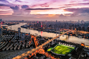 Birds eye view of the traffic light trail and Shanghai cityの写真素材 [FYI02347535]