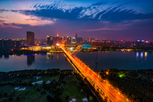 Traffic light trail on the bridge with Shenyang Chinaの写真素材 [FYI02347654]