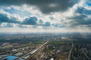Birds eye view of the city with the cloudy skyの写真素材 [FYI02347667]