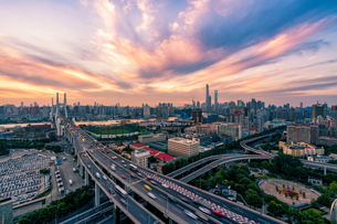 The Traffic trail on the freeway and the City with the magic atmosphereの写真素材 [FYI02348383]