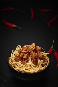 Spicy fish and rice noodles on a dark backgroundの写真素材 [FYI02348848]