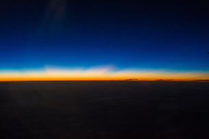 Sunlight breaking the dark night; looking from the airplaneの写真素材 [FYI02348930]