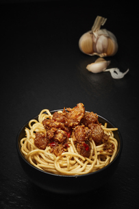 Spicy fish and rice noodles on a dark backgroundの写真素材 [FYI02349607]