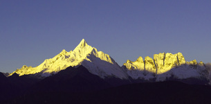 Sunlight shadow covers the Meili Snow Mountains,Yunnan.Chinaの写真素材 [FYI02351947]