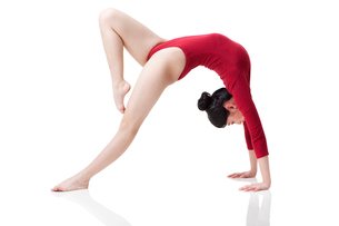 Female gymnast performing rhythmic gymnasticsの写真素材 [FYI02629752]