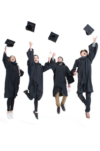 Happy college graduates throwing mortar boardsの写真素材 [FYI02638470]