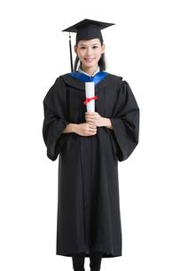 Happy college graduate in graduation gownの写真素材 [FYI02638471]