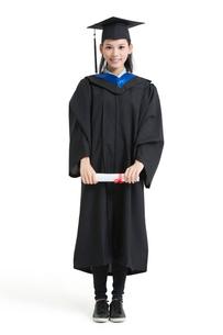 Happy college graduate in graduation gownの写真素材 [FYI02638477]