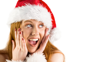 Festive redhead with hands on faceの写真素材 [FYI02639491]