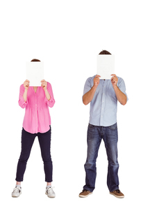 People holding sheets over facesの写真素材 [FYI02640777]