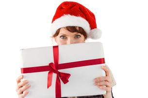 Woman holding a christmas presentの写真素材 [FYI02640784]
