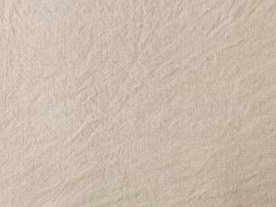 ベージュの麻の洗いざらしの布の写真素材 [FYI02653960]