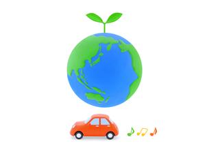 地球と新芽と車の写真素材 [FYI02674213]