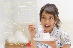 ケーキを食べる女性のイラスト素材 [FYI02682115]