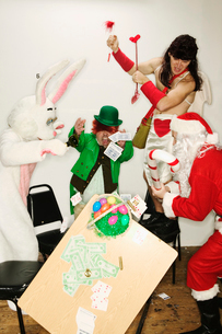 Holiday mascots wrecking a card tableの写真素材 [FYI02685235]