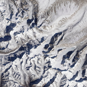 Satellite view of a Himalayan glacier surrounded by mountainの写真素材 [FYI02689583]