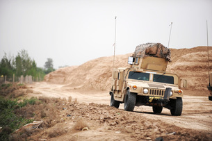 A Humvee conducts security during a patrol in the Iraqi villの写真素材 [FYI02689638]