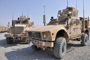 An M-ATV Mine Resistant Ambush Protected vehicle parked nextの写真素材 [FYI02690178]