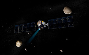 Artist's concept of the Dawn spacecraft in orbit around theの写真素材 [FYI02690284]