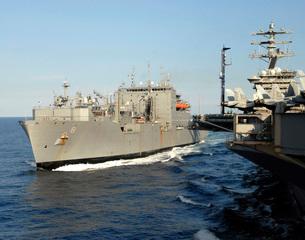 Dry cargo and ammunition ship USNS Wally Schirra transits alの写真素材 [FYI02690323]