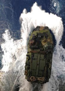 An amphibious assault vehicle exits the well deck of USS Essの写真素材 [FYI02690384]