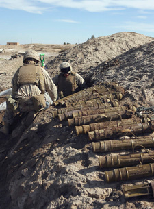 Soldiers unearth 82mm Chinese mortars from a weapons cache.の写真素材 [FYI02690386]