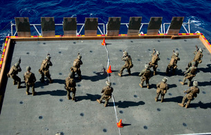 Marines fire rounds at targets on the aircraft elevator aboaの写真素材 [FYI02690432]