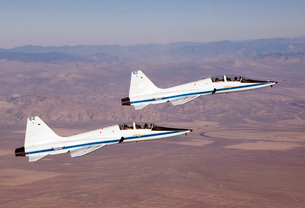 Two T-38A mission support aircraft fly in tight formation.の写真素材 [FYI02690469]