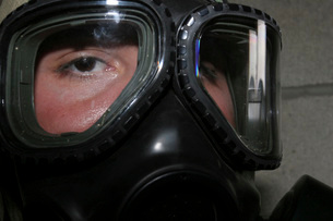 A Marine glares through the limited-spaced eye protection paの写真素材 [FYI02690708]