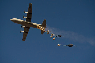 A U. S. Air Force C-130 Hercules airdrops 20 bundles over Afの写真素材 [FYI02690717]