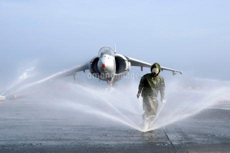 Damage Controlman Fireman checks sprinklers on the counter mの写真素材 [FYI02690924]