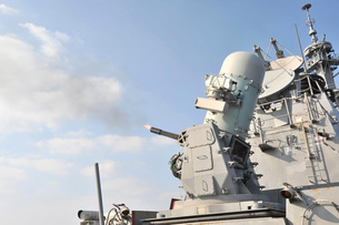 A phalanx close-in weapons system is fired aboard USS Lassenの写真素材 [FYI02690997]