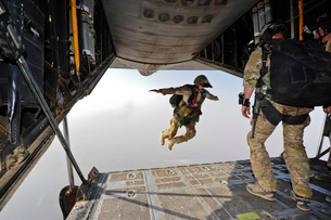 A U.S. Air Force pararescueman jumps out of an HC-130P Combaの写真素材 [FYI02691092]