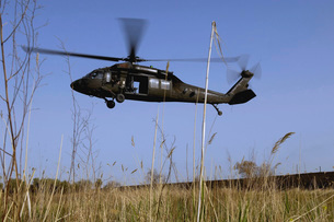 A U.S. Army UH-60 Black Hawk helicopter prepares to pick upの写真素材 [FYI02691203]