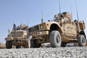 An M-ATV Mine Resistant Ambush Protected vehicle parked nextの写真素材 [FYI02691348]