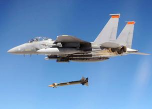 An F-15E Strike Eagle drops a GBU-28 bomb during a Combat Haの写真素材 [FYI02691475]