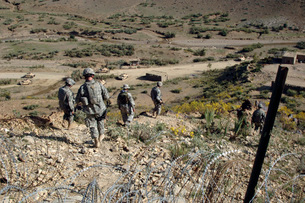 U.S Army Soldiers walk back to their humvee from a border chの写真素材 [FYI02691482]
