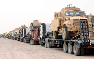 A convoy of Mine-Resistant Ambush Protected vehicles ready fの写真素材 [FYI02691542]