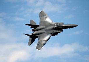 An F-15E Strike Eagle soars through the sky.の写真素材 [FYI02691613]