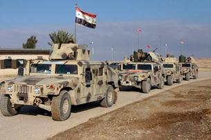 Iraqi Army soldiers aboard M1114 humvee vehicles.の写真素材 [FYI02691661]