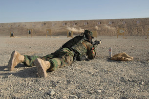 An Afghan Commando engages training targets on the firing raの写真素材 [FYI02691669]