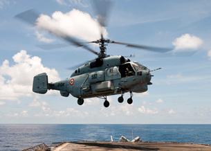 An Indian Navy Kamov Ka-31  lands on the flight deck of USSの写真素材 [FYI02691679]